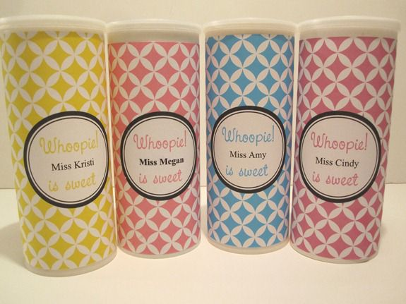Personalized containers of whoopie cookies are ready to gift.