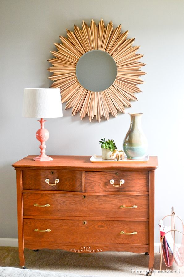 wood starburst mirror with serpentine dresser