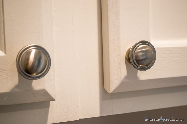 Laundry room cabinets small space laundry room area for Laundry room door knobs